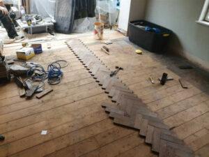 reclaimed herringbone parquet floor image 1